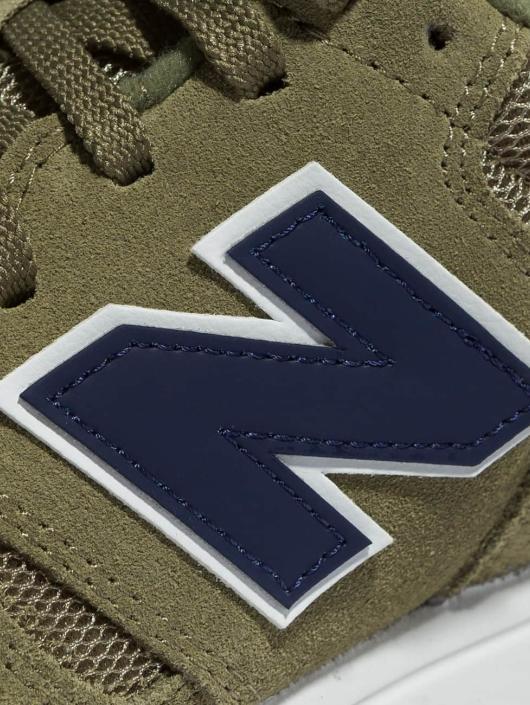 New Balance Sneaker ML565 grün