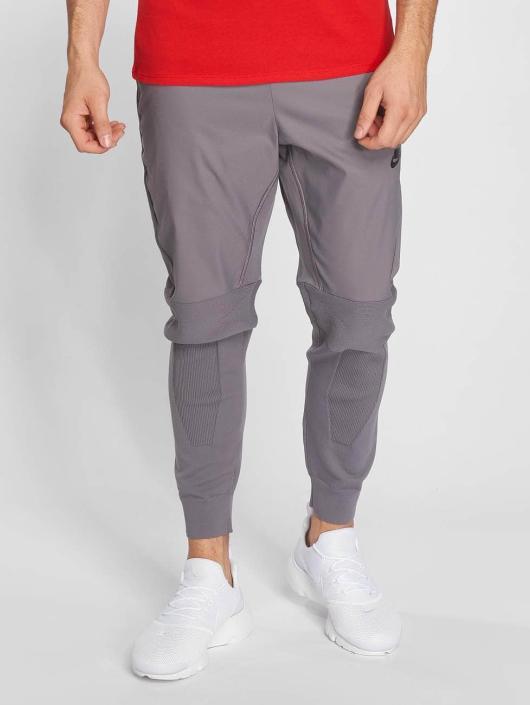 Nike Спортивные брюки Sportswear Tech Knit серый