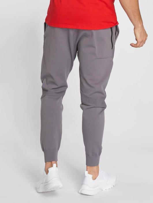 Nike Pantalón deportivo Sportswear Tech Knit gris