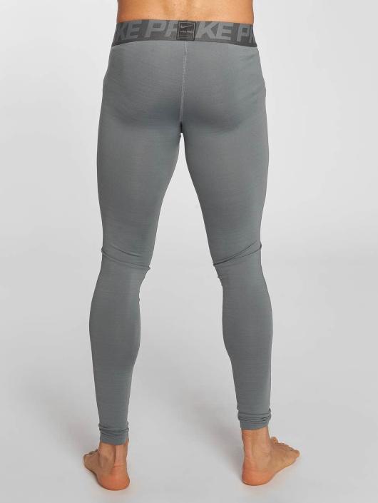 Nike Performance Леггинсы Pro Warm серый