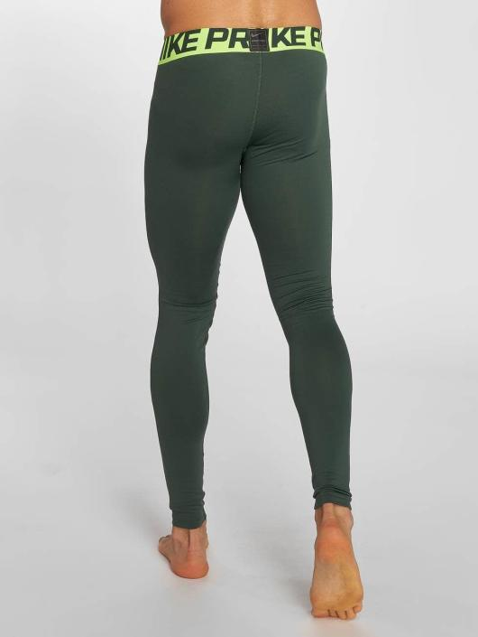 Nike Performance Leggings/Treggings Pro Warm oliwkowy