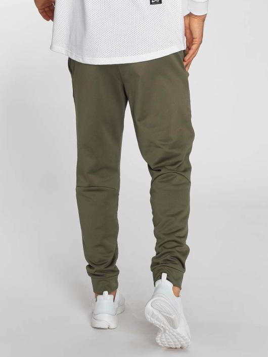 Nike Spodnie do joggingu Therma zielony