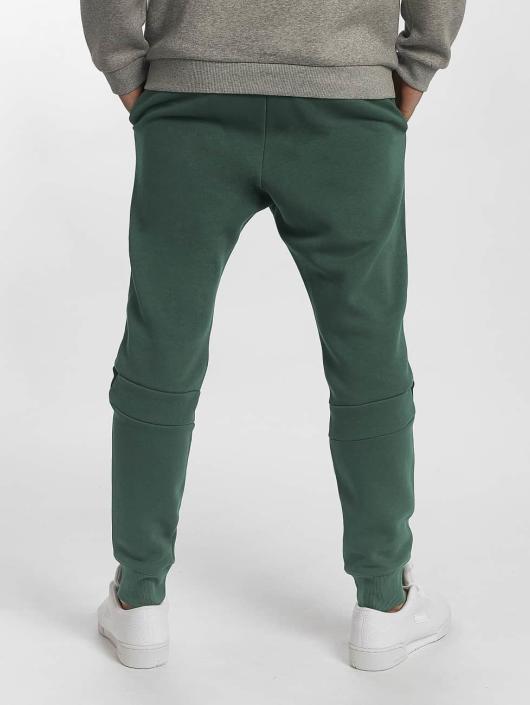 Reebok Спортивные брюки EF Jogger зеленый