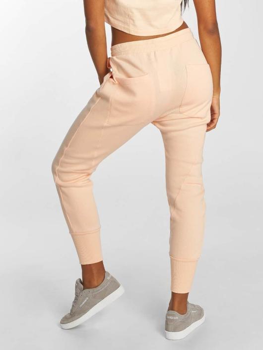 Reebok Спортивные брюки DC розовый