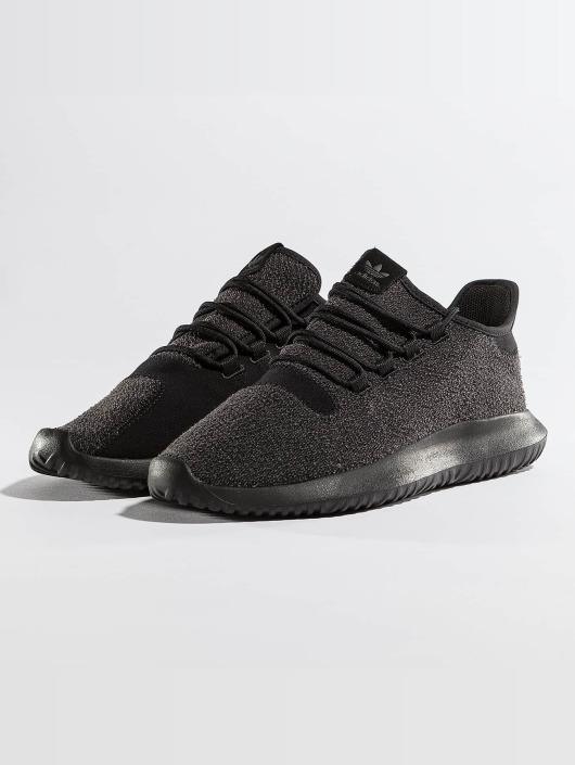 adidas tubular schwarz weisse sohle mit punktenflecken