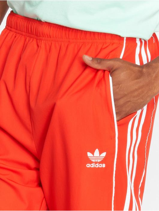 adidas originals Спортивные брюки Auth Wind красный
