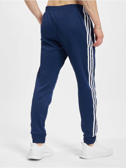 adidas Originals Спортивные брюки SST синий