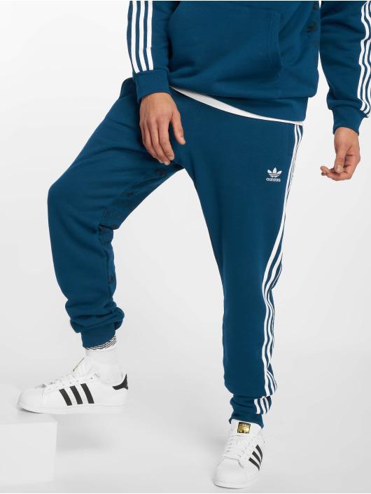 24f84bf3e8d15 adidas originals   Monogram bleu Homme Jogging 598739