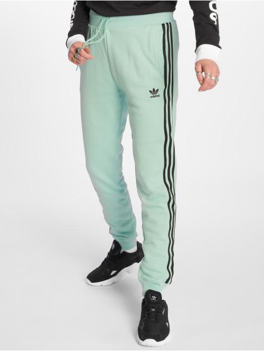 f0245a98e0765a adidas originals Damen Jogginghose Cuf in grün 542808