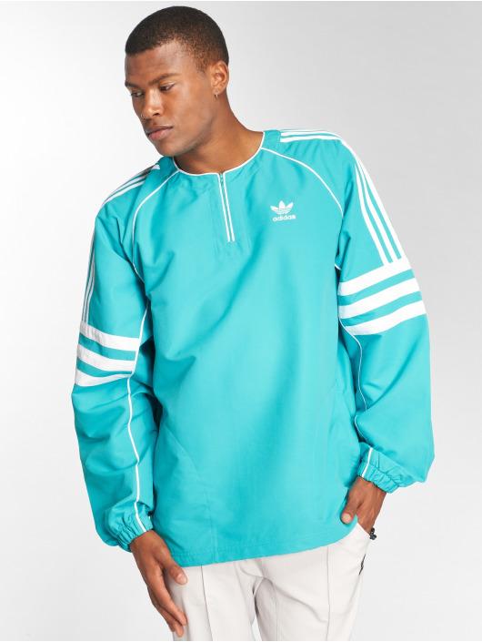 adidas originals Kurtki przejściowe Auth Wvn Tunic niebieski