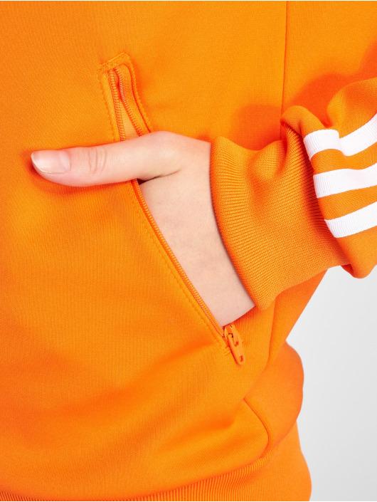 adidas originals Kurtki przejściowe Sst Tt Transition pomaranczowy