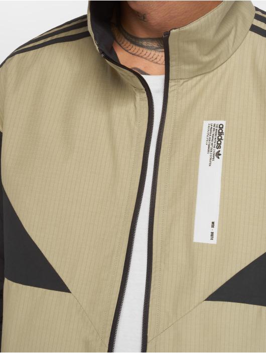 adidas originals Kurtki przejściowe Originals Nmd Track Top zloty