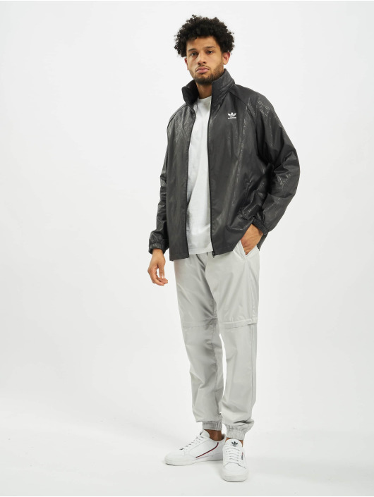 adidas Originals Prechodné vetrovky Mono Aop èierna