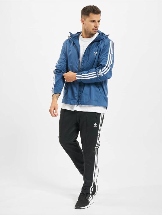adidas Originals Prechodné vetrovky Lock Up modrá
