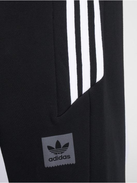 adidas originals Spodnie do joggingu Tech czarny