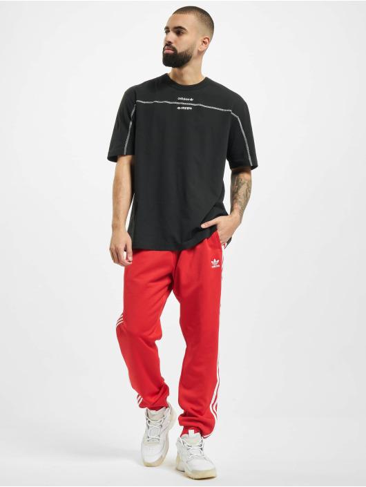 adidas Originals Spodnie do joggingu SST czerwony