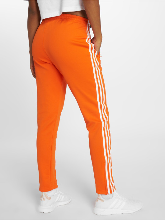 adidas originals Spodnie do joggingu Sst Tp pomaranczowy