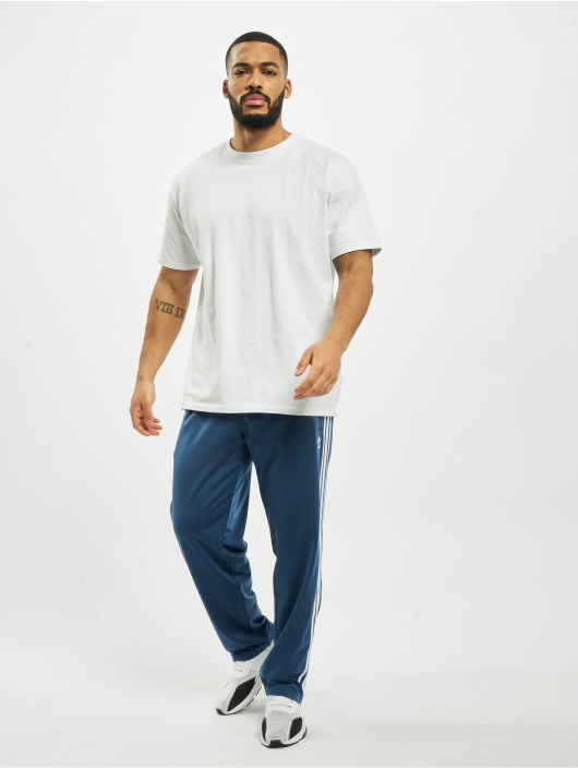 adidas Originals tepláky Firebird modrá