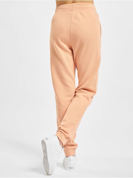 adidas Originals tepláky Track oranžová