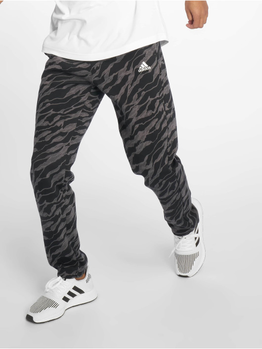 af7d5b44ce7e1 adidas Performance | ESS AOP gris Homme Pantalons de jogging 583181