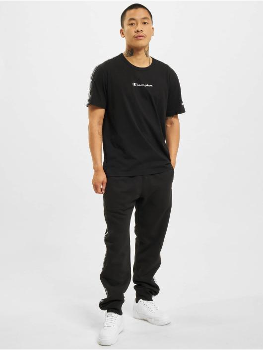 Champion Spodnie do joggingu Logo Tape czarny