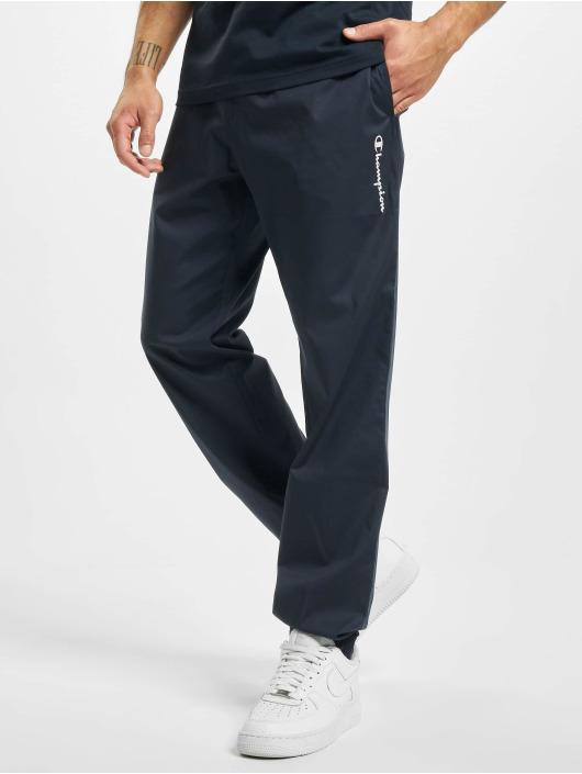 Champion Spodnie do joggingu Legacy niebieski