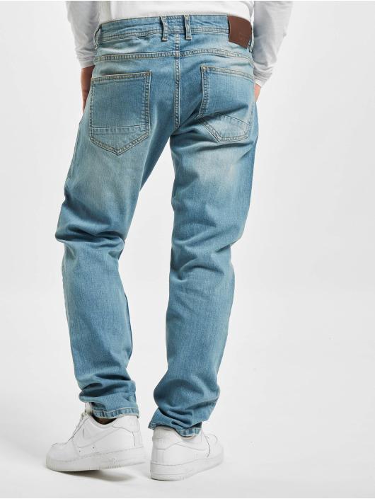 DEF dżinsy przylegające Alperen niebieski