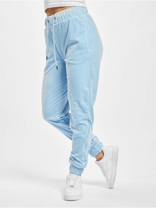 Karl Kani Spodnie do joggingu Signature niebieski
