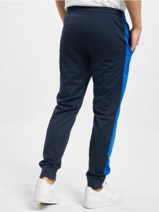 Lacoste Joggingbyxor Sport blå