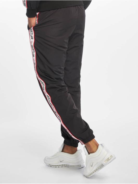 Merchcode Spodnie do joggingu Hustler Tape czarny