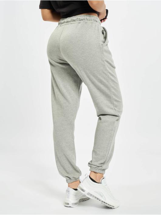 Missguided Jogging kalhoty 90s Oversized šedá