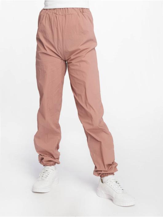 Missguided Spodnie do joggingu 80s Nylon rózowy