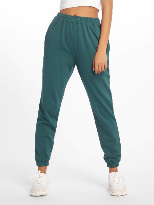 Missguided Spodnie do joggingu 80s turkusowy