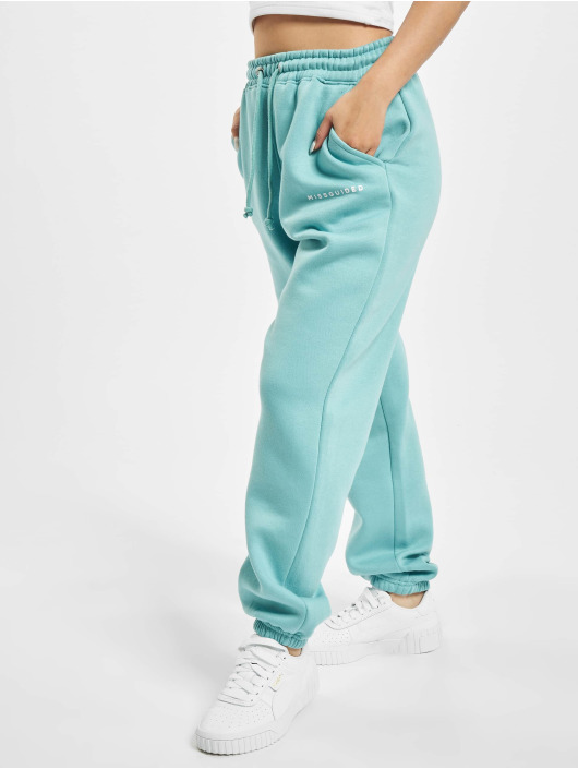 Missguided Spodnie do joggingu Oversized 90s turkusowy