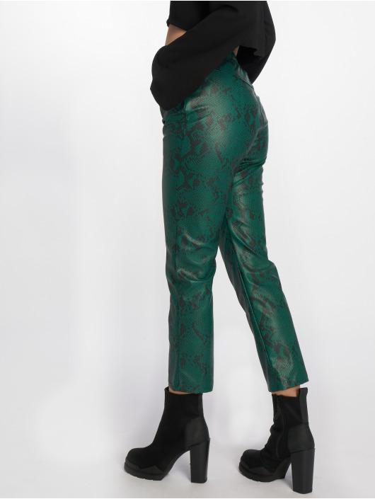 NA-KD Spodnie wizytowe Snake Printed PU zielony