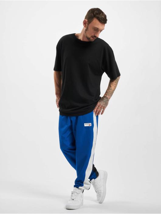 New Balance Joggebukser Athletics Windbreaker blå