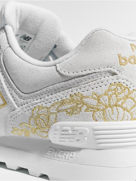 New Balance Sneaker WL574 grau