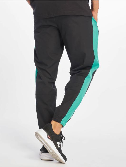 New Balance Spodnie do joggingu MP91507 czarny