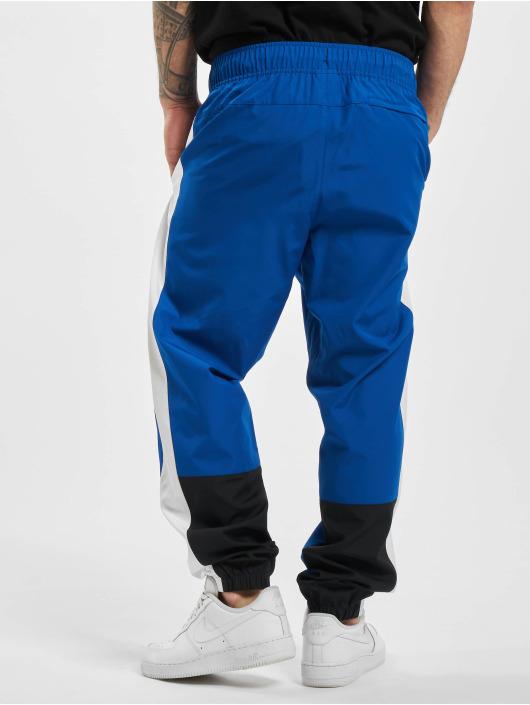 New Balance Spodnie do joggingu Athletics Windbreaker niebieski