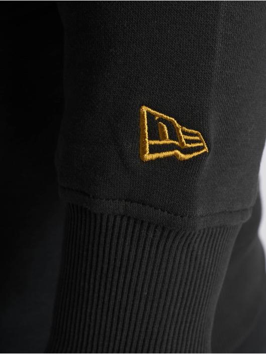 New Era Bluzy z kapturem Team Logo New Orleans Saints czarny