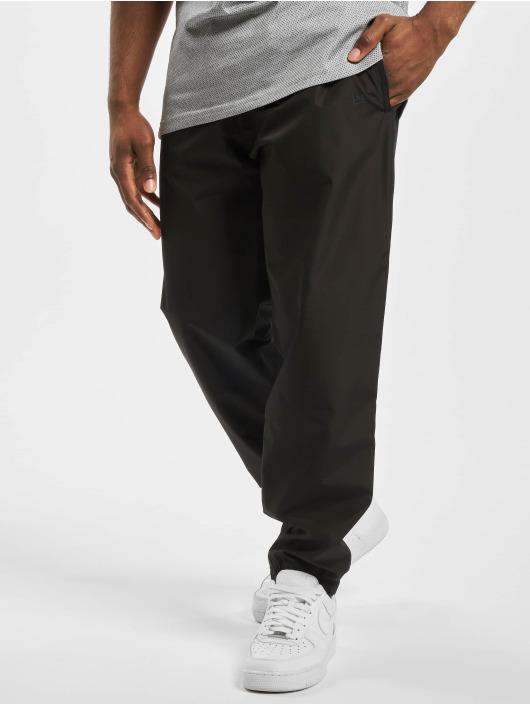 New Era Spodnie do joggingu Technical czarny