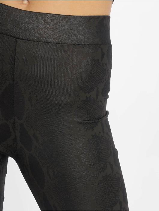 New Look Leggings/Treggings Wetlook Snakeskin czarny