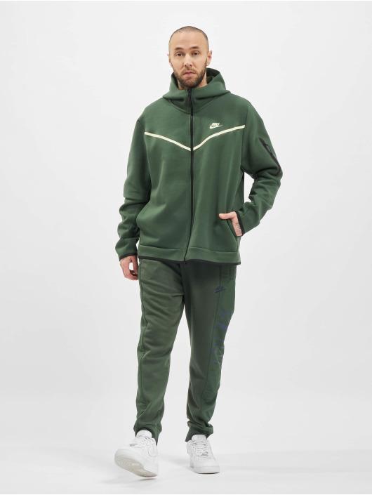 Nike Спортивные брюки M Nsw Ce Ft Jggr Snl зеленый