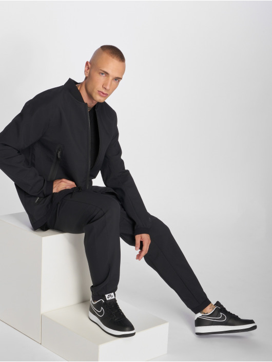 Nike Спортивные брюки Sportswear Tech Pack черный