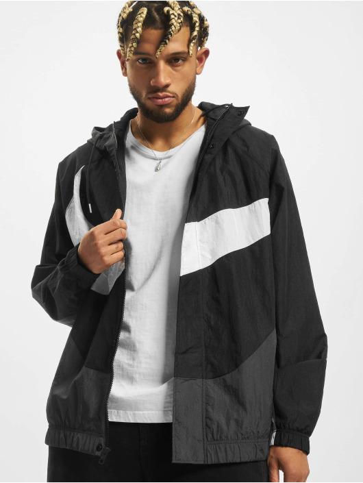 Nike Chaqueta de entretiempo Swoosh Woven Lnd negro