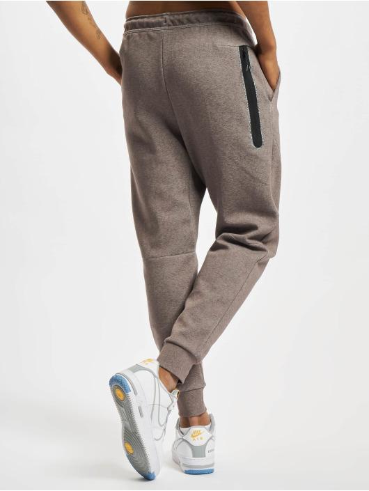 Nike Jogging kalhoty Nsw Revival hnědý