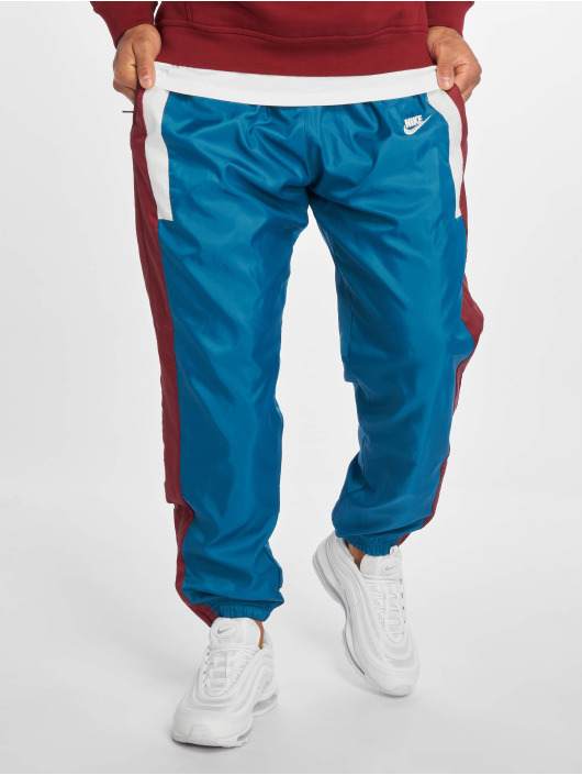Sportschuhe Beste am besten geliebt Nike Sportswear Sweat Pants Green Abyss/Team Red/Sail/Sail