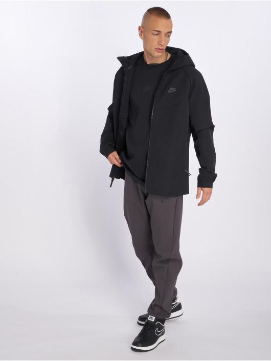 Nike Kurtki przejściowe Tech Pack czarny