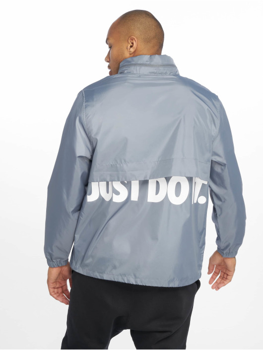 Nike Kurtki przejściowe JDI HD Woven niebieski