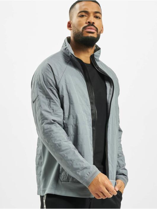 Nike Kurtki przejściowe Tech Pack Quilted szary